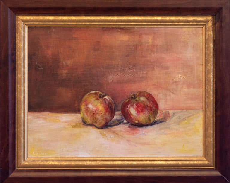 Photo of a painting in a frame, where two apples are leaning towards each other on a yellow table against a mahogany wall.