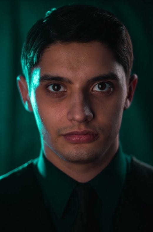 Headshot photo of a gentleman with a green