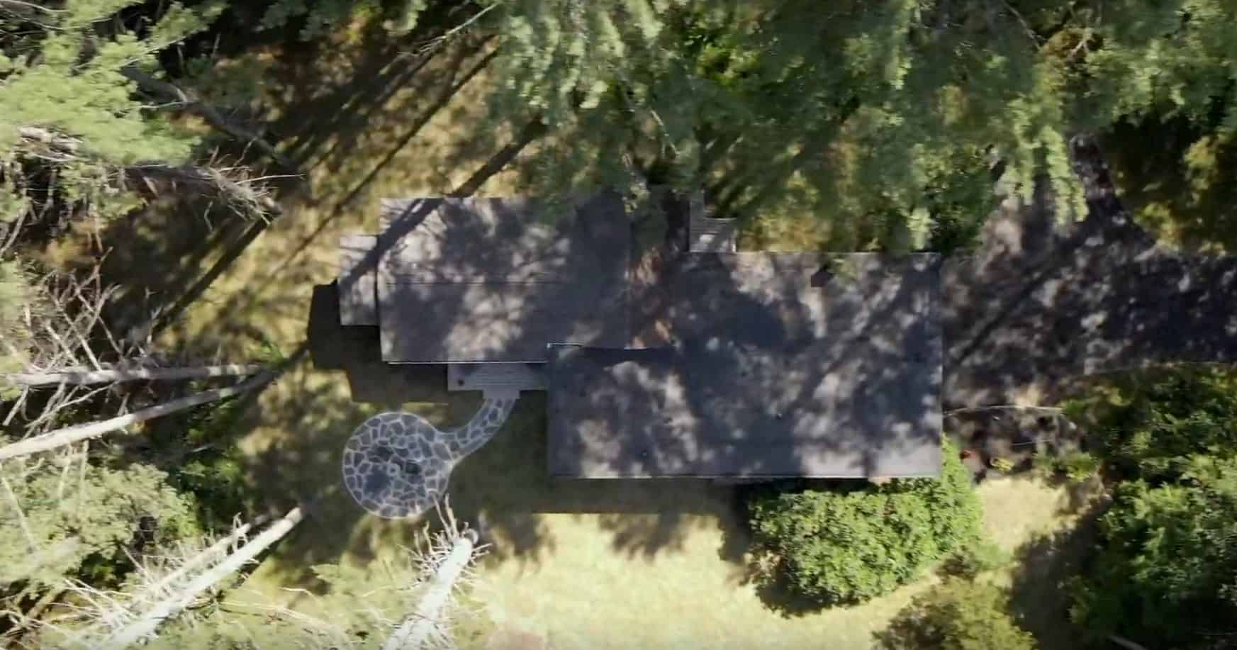 Photo thumbnail of a house in the woods, birds eye view.